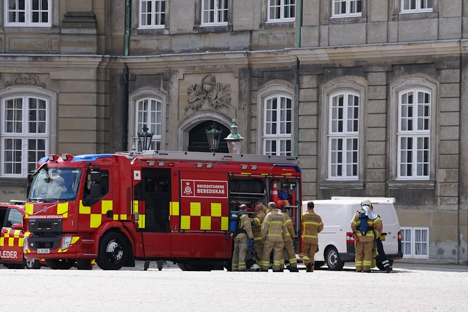 Emergency workers are seen at the Royal Palace Amalienborg