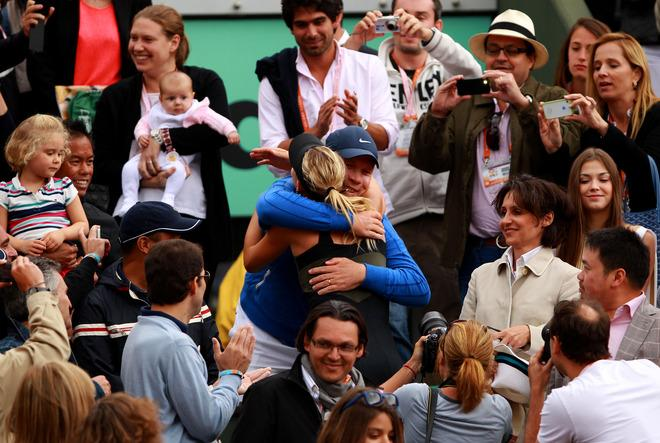 PARIS, FRANCE - JUNE 09:  Maria Sharapova of Russia hugs her coach Thomas Hogstedt as she celebrates victory eith her team in the box after the women's singles final against Sara Errani of Italy during day 14 of the French Open at Roland Garros on June 9, 2012 in Paris, France.  (Photo by Clive Brunskill/Getty Images)