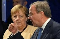 The conservatives lost the constituency Angela Merkel (L) had held since 1990 (AFP/John MACDOUGALL)