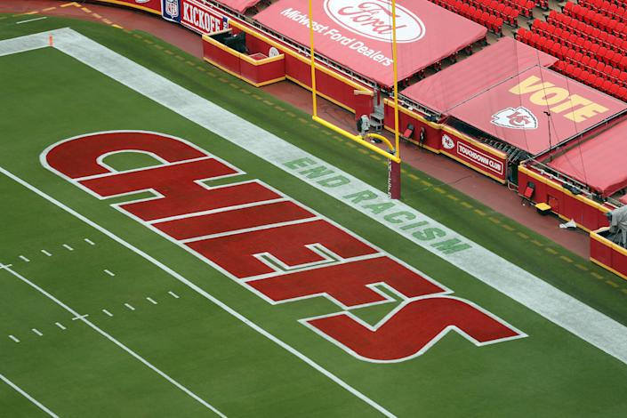 "A detail of a saying ""End Racism"" is seen painted in the end zone."