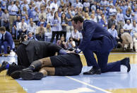 Duke head coach Mike Krzyzewski checks on an injured Marques Bolden during the first half of an NCAA college basketball game against North Carolina in Chapel Hill, N.C., Saturday, March 9, 2019. (AP Photo/Gerry Broome)