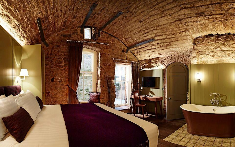 """<p>Step back in time to the 15th century at the Cheval Old Town Chambers, which sits behind a discreet doorway on Advocates Close in the heart of the Scottish capital, just a five-minute walk from Edinburgh Castle. </p><p>On the ground level of this apartment is the Master Bedroom with a Super King-size bed and a freestanding copper bathtub. On the second floor, there's an open-plan bathroom (decorated with gothic-style candles) and an open-plan kitchen dining and living space. This is a next level home-from-home staycation.</p><p><a class=""""link rapid-noclick-resp"""" href=""""https://go.redirectingat.com?id=127X1599956&url=https%3A%2F%2Fwww.booking.com%2Fhotel%2Fgb%2Fthe-chambers-edinburgh.en-gb.html%3Faid%3D311076%26label%3Dthe-chambers-edinburgh-1zqxUjqLUzmk0qmTErygWgS114157449520%253Apl%253Ata%253Ap1%253Ap2%253Aac%253Aap%253Aneg%253Afi%253Atiaud-297601666475%253Akwd-62092174088%253Alp9045908%253Ali%253Adec%253Adm%253Appccp%253DUmFuZG9tSVYkc2RlIyh9YVujEjbMrKBVEQO8hCDrg-c%26sid%3D479d225600bb120a680b84f372f8be2c%26dest_id%3D-2595386%26dest_type%3Dcity%26group_adults%3D2%26group_children%3D0%26hapos%3D1%26hpos%3D1%26no_rooms%3D1%26sr_order%3Dpopularity%26srepoch%3D1618220078%26srpvid%3Da157435695510031%26ucfs%3D1%26from%3Dsearchresults%23hotelTmpl&sref=https%3A%2F%2Fwww.elle.com%2Fuk%2Flife-and-culture%2Ftravel%2Fg36092668%2Fbest-staycations-uk%2F"""" rel=""""nofollow noopener"""" target=""""_blank"""" data-ylk=""""slk:BOOK HERE"""">BOOK HERE</a></p>"""