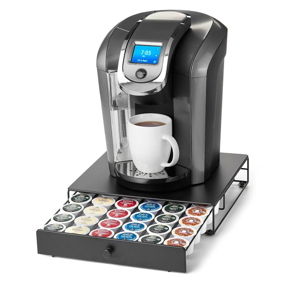 "<p>Say goodbye to searching for coffee pods half asleep! The <a href=""https://www.popsugar.com/buy/Nifty-Capacity-Under--Brewer-Drawer-472060?p_name=Nifty%20Capacity%20Under-the-Brewer%20Drawer&retailer=target.com&pid=472060&price=17&evar1=moms%3Aus&evar9=46418295&evar98=https%3A%2F%2Fwww.popsugar.com%2Ffamily%2Fphoto-gallery%2F46418295%2Fimage%2F46418301%2FNifty-Capacity-Under--Brewer-Drawer&list1=shopping%2Ctarget%2Corganization%2Chome%20shopping&prop13=api&pdata=1"" rel=""nofollow"" data-shoppable-link=""1"" target=""_blank"" class=""ga-track"" data-ga-category=""Related"" data-ga-label=""https://www.target.com/p/nifty-36-capacity-under-the-brewer-drawer/-/A-14131083"" data-ga-action=""In-Line Links"">Nifty Capacity Under-the-Brewer Drawer</a> ($17) keeps them all in one place, right beneath your Keurig.</p>"