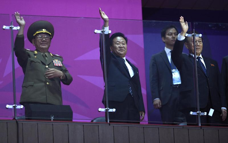 (From L) North Korean director of the military's General Political Bureau, along with other N.Korean officials, wave to athletes during the closing ceremony of the Asian Games, at the Incheon Asiad Main Stadium in South Korea, on October 4, 2014 (AFP Photo/Martin Bureau)