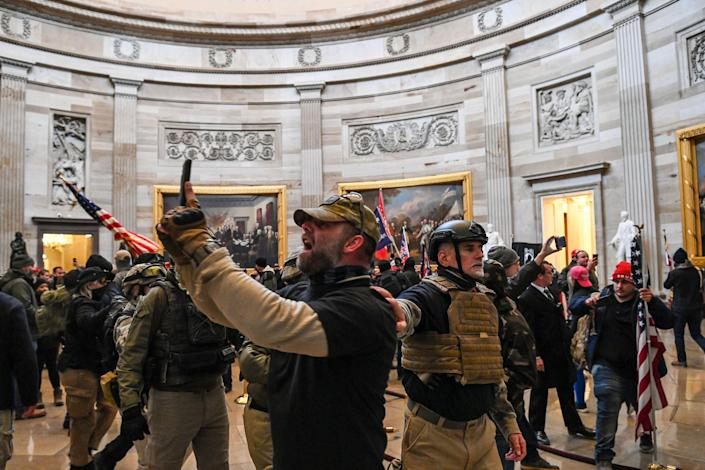 """Supporters of President Donald Trump in the US Capitol's Rotunda after breeching police barriers in Washington, DC, on Jan. 6, 2021.<span class=""""copyright"""">Saul Loeb—AFP/Getty Images</span>"""