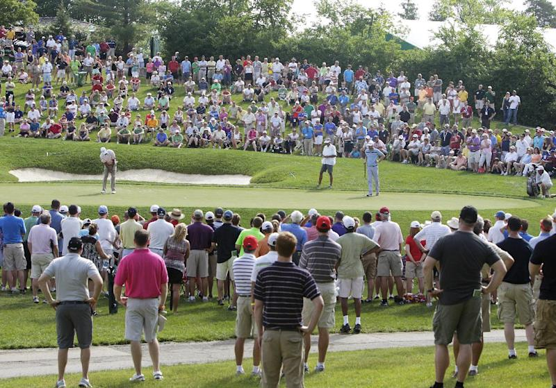 Tiger Woods putts on 14th hole during the second round of the Memorial golf tournament Friday, May 31, 2013, in Dublin, Ohio. (AP Photo/Jay LaPrete)