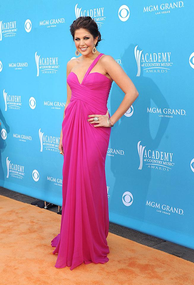 """Hillary Scott of Lady Antebellum  Grade: B+   The night was a huge hit all around for Hillary Scott, who glowed in an attention-grabbing fuchsia frock and upswept tresses before walking inside to nab several awards with her Lady Antebellum bandmates, including Top Vocal Group. Denise Truscello/<a href=""""http://www.wireimage.com"""" target=""""new"""">WireImage.com</a> - April 18, 2010"""