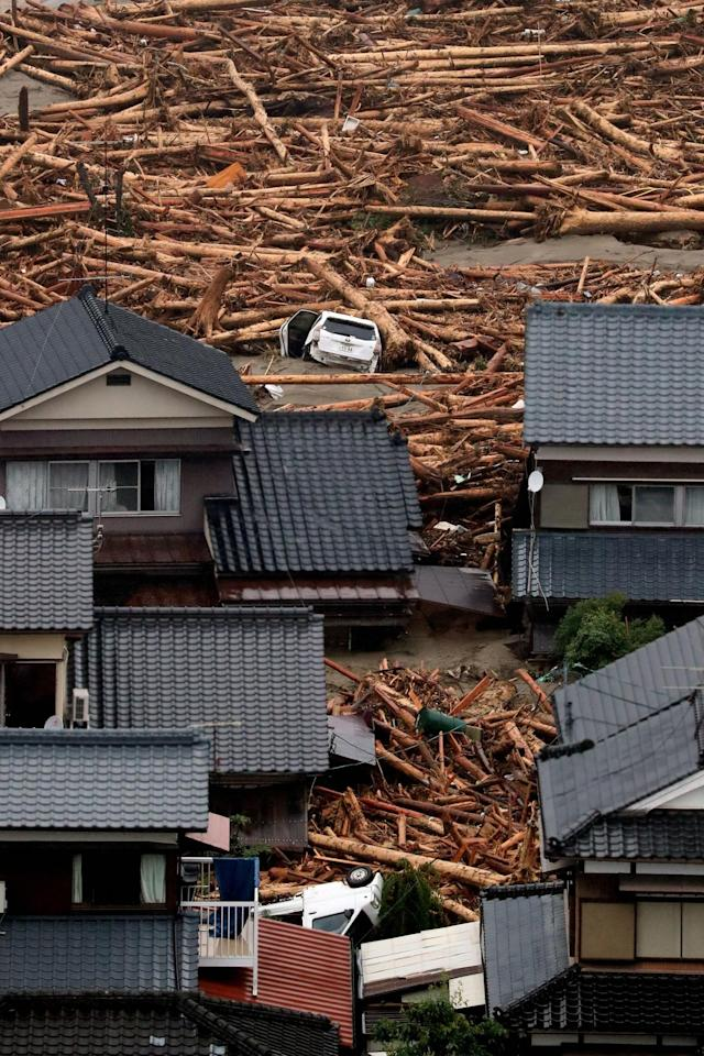 <p>In this aerial image, cars are washed away among driftwood as torrential rain hit on July 6, 2017 in Asakura, Fukuoka, Japan. (Photo: The Asahi Shimbun via Getty Images) </p>