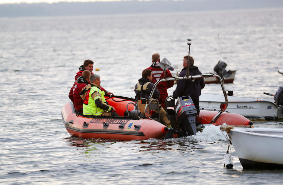 <em>Police found Ms Wall's body parts weighed down in bags in the water (Rex)</em>