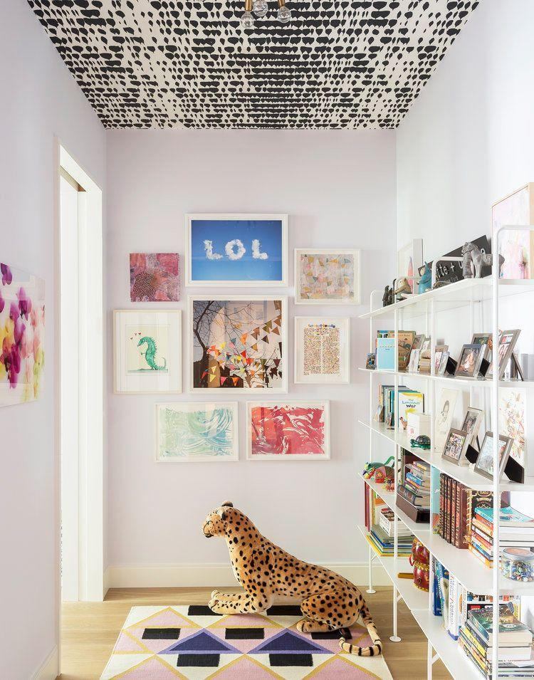 <p>When space in the playroom is limited, use your five walls strategically. Take note from Studio DB and wallpaper the ceiling, build a gallery wall with a sense of humor, bring in as much shelving as possible, and opt for a vibrant area rug. </p>