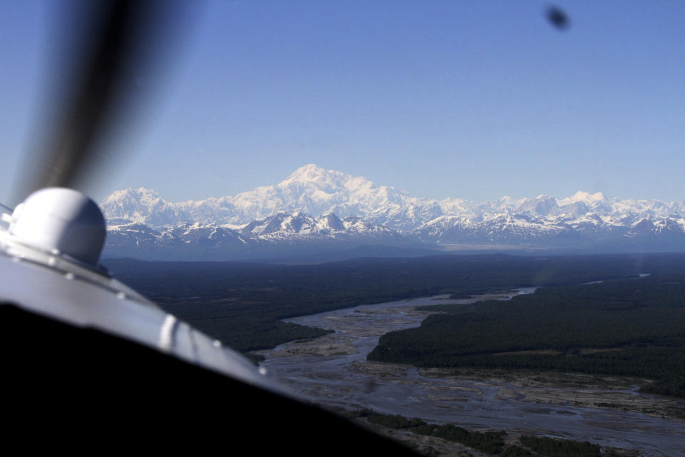 This May 28, 2016, photo shows Denali as a sightseeing airplane filled with tourist approaches Denali, North America's tallest mountain, after taking off from Talkeetna, Alaska. Sightseeing planes won't be in high demand this summer after most major cruise ship companies canceled their summer tourist seasons due to the coronavirus pandemic. As a result nearly half of Alaska's annual 2.2 million visitors won't be visiting the nation's northernmost state. (Ron Barta via AP)