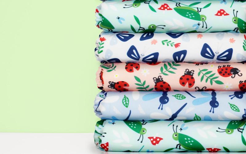 Some environmentally-conscious friendly parents are coughing up more than £100 for trendy nappy designs - Bambino Mio