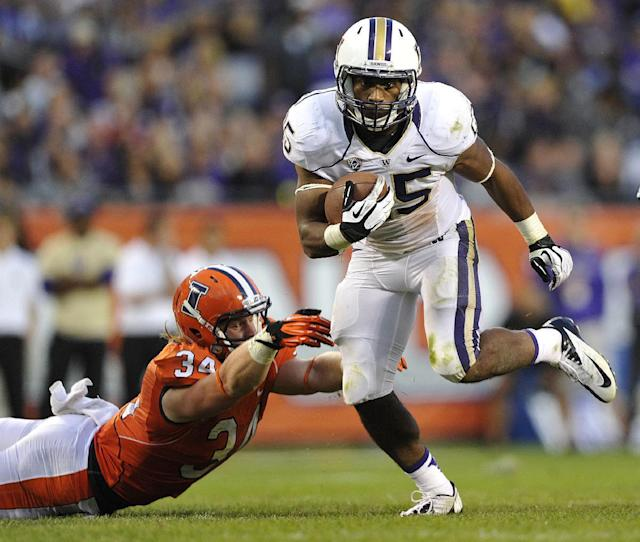 Illinois' Mike Svetina (34) misses the tackle as Washington's Bishop Sankey heads upfield during the second half of an NCAA college football game Saturday, Sept. 14, 2013, in Chicago. (AP Photo/Jim Prisching)