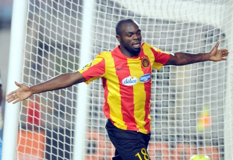 Cameroonian Yannick Ndjeng celebrates scoring for previous club Esperance of Tunisia in the CAF Champions League.