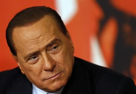 Italy's former PM Berlusconi attends a news conference in Rome