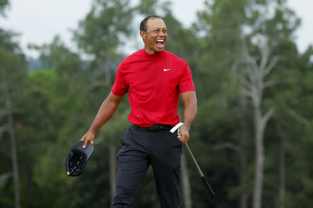 FILE PHOTO: Golf - Masters - Augusta National Golf Club - Augusta, Georgia, U.S. - April 14, 2019 - Tiger Woods of the U.S. celebrates on the 18th hole after winning the 2019 Masters. REUTERS/Brian Snyder