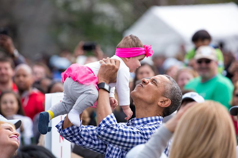 Obama plays with a baby at the 138th Annual Easter Egg Roll at the White House in March 2016. (Photo: NurPhoto via Getty Images)