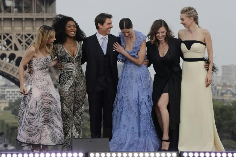 US actor Tom Cruise shares a joke with (From L) French actress Alix Benezech, US actresses Angela Bassett and Michelle Monaghan, Swedish actress Rebecca Ferguson and English actress Vanessa Kirby as they pose in front of the Eiffel Tower after the red carpet premiere of the film Mission: Impossible – Fallout in Paris