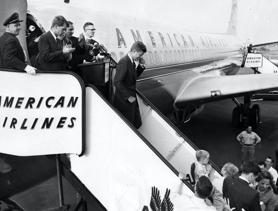 """<span class=""""caption"""">A crowd greets Sen. John F. Kennedy at Logan Airport in Boston on July 17, 1960, after he became the Democratic nominee for president.</span> <span class=""""attribution""""><a class=""""link rapid-noclick-resp"""" href=""""https://www.gettyimages.com/detail/news-photo/sen-john-f-kennedy-exits-the-plane-at-logan-airport-in-news-photo/695691496?adppopup=true"""" rel=""""nofollow noopener"""" target=""""_blank"""" data-ylk=""""slk:John M. Hurley/The Boston Globe via Getty Images"""">John M. Hurley/The Boston Globe via Getty Images</a></span>"""
