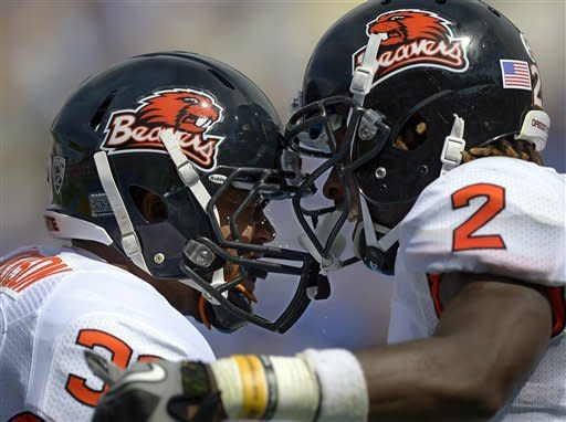 Oregon State wide receiver Markus Wheaton, right, celebrates his touchdown with teammate fullback Tyler Anderson during the first half of their NCAA college football game against UCLA, Saturday, Sept. 22, 2012, in Pasadena, Calif. (AP Photo/Mark J. Terrill)