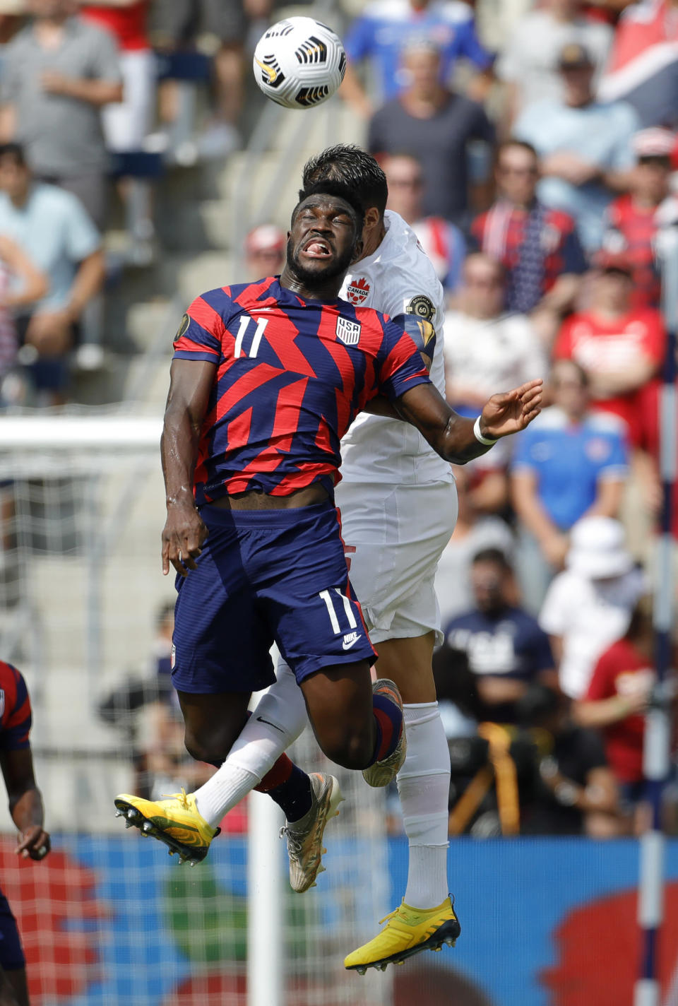 U.S. forward Daryl Dike (11) and Canada defender Steven Vitoria go up for the ball during the first half of a CONCACAF Gold Cup soccer match in Kansas City, Kan., Sunday, July 18, 2021. (AP Photo/Colin E. Braley)