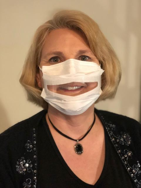 Image: Dr. Anne McIntosh, President of Safe'N'Clear, Inc., wearing a communicator mask. (Courtesy of Safe'N'Clear)