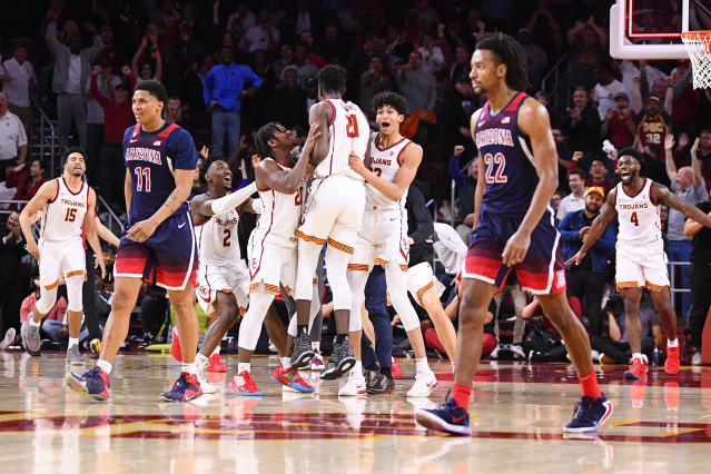 """<a class=""""link rapid-noclick-resp"""" href=""""/ncaab/players/153901/"""" data-ylk=""""slk:Onyeka Okongwu"""">Onyeka Okongwu</a> hit his first 3-pointer of the season on Thursday night — but did so from the other end of the court. (Brian Rothmuller/Icon Sportswire/Getty Images)"""