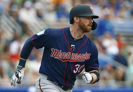 Mar 17, 2019; Dunedin, FL, USA; Minnesota Twins left fielder Michael Reed (30) hits a sacrifice fly during the second inning of a game against the Toronto Blue Jays at Dunedin Stadium. Mandatory Credit: Butch Dill-USA TODAY Sports