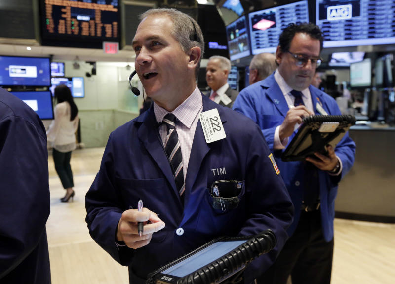 Trader Timothy Nick, left, works on the floor of the New York Stock Exchange Thursday, April 24, 2014. Mixed earnings from a large number of U.S. companies left the stock market without direction early Thursday, despite positive results from a handful of names including Apple and Caterpillar. (AP Photo/Richard Drew)