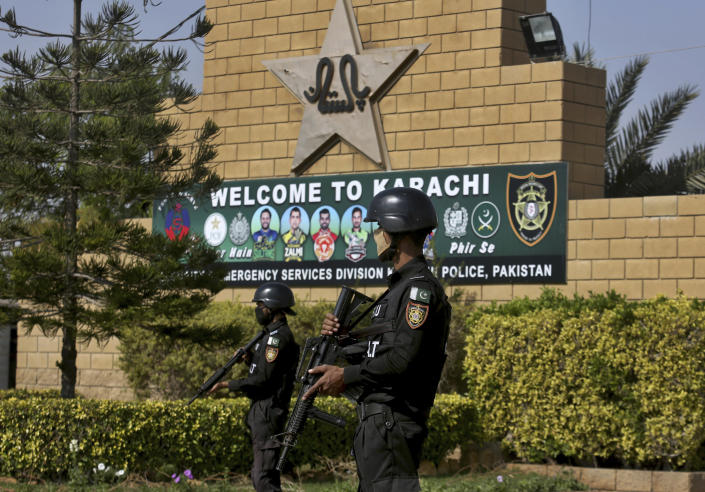 Pakistan police commandos stand guard outside the National Stadium, where the Pakistan Cricket Team is practicing for the upcoming test match against South Africa, in Karachi, Pakistan, Thursday, Jan. 21, 2021. Pakistan will play the first test match on Jan. 26, against South Africa's cricket team, who arrived in Karachi last Saturday for the first time in nearly 14 years. (AP Photo/Fareed Khan)