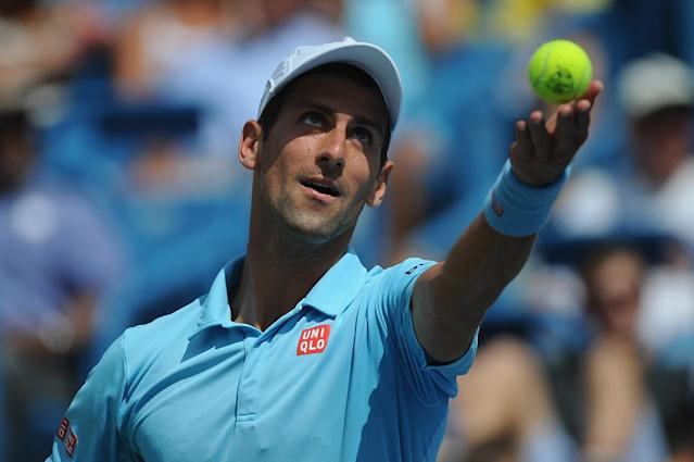 Novak Djokovic of Serbia serves against Tommy Robredo of Spain during a match on day 6 of the Western & Southern Open at the Linder Family Tennis Center on August 14, 2014 in Cincinnati, Ohio (AFP Photo/Jonathan Moore)