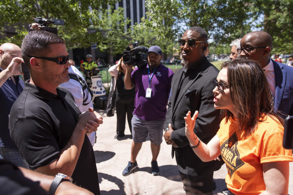 Will Haraway, an NRA supporter, argues with Alyssa Milano, founder of NoRA, during a protest against the National Rifle Association in Dallas on May 5. (Photo: AP Photo/Rex Curry)
