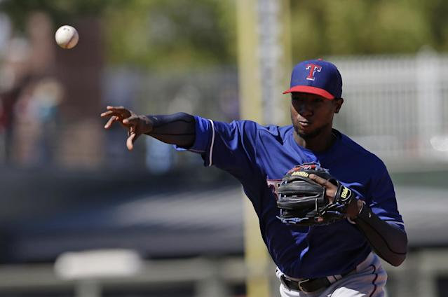 Texas Rangers' Jurickson Profar throws out Kansas City Royals' Jarrod Dyson at first base during the fourth inning of a spring exhibition baseball game, Saturday, March 22, 2014, in Surprise, Ariz. (AP Photo/Darron Cummings)