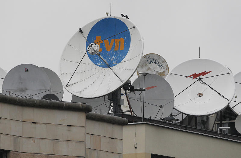 FILE - In this Sept. 12, 2017 file photo, satellite dishes sit on top of the headquarters of the TVN independent and popular TV network in Warsaw, Poland. Polish national prosecutors said Sunday, Nov.  25, 2018 that they are canceling a criminal investigation into a reporter for a U.S.-owned broadcaster on suspicions of propagating fascism for having gone undercover to film neo-Nazis. TVN, owned by Discovery, broadcast undercover footage in January that showed members of a Polish neo-Nazi group celebrating Adolf Hitler's birthday in a forest in 2017. (AP Photo/Czarek Sokolowski, file)