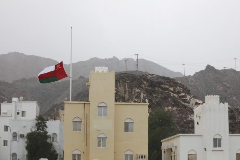 Oman's national flag flies at half mast after the death of Oman's Sultan Qaboos bin Said was announced in Muscat