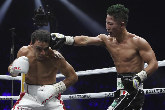 Japan's Takuma Inoue, right, sends a right to France's Nordine Oubaali in the 12th round of their WBC world bantamweight title match in Saitama, Japan, Thursday, Nov. 7, 2019. Oubaali defeated Inoue by a unanimous decision. (AP Photo/Toru Takahashi)
