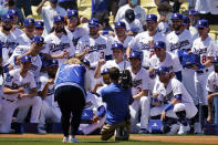 Members of the Los Angeles Dodgers pose for photos with their 2020 World Series Championship ring before a baseball game against the Washington Nationals, Friday, April 9, 2021, in Los Angeles. (AP Photo/Marcio Jose Sanchez)