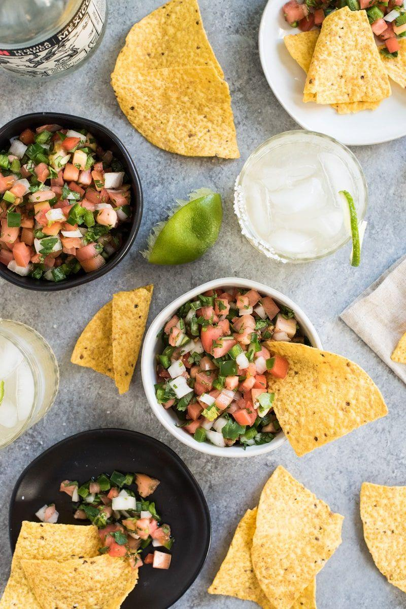 """<p>Every summer party needs a fun appetizer or dip like this fresh pico de gallo. It's bright, spicy, and pairs perfectly with <a href=""""https://www.thepioneerwoman.com/food-cooking/recipes/a35726378/how-to-make-homemade-tortilla-chips/"""" rel=""""nofollow noopener"""" target=""""_blank"""" data-ylk=""""slk:tortilla chips"""" class=""""link rapid-noclick-resp"""">tortilla chips</a>. If you're really a fan, you can also use to top tacos, steak, or fajitas. </p><p><strong>Get the recipe at <a href=""""https://www.isabeleats.com/mexican-pico-de-gallo-recipe/"""" rel=""""nofollow noopener"""" target=""""_blank"""" data-ylk=""""slk:Isabel Eats"""" class=""""link rapid-noclick-resp"""">Isabel Eats</a>. </strong></p><p><a class=""""link rapid-noclick-resp"""" href=""""https://go.redirectingat.com?id=74968X1596630&url=https%3A%2F%2Fwww.walmart.com%2Fsearch%2F%3Fquery%3Dpioneer%2Bwoman%2Bmixing%2Bbowls&sref=https%3A%2F%2Fwww.thepioneerwoman.com%2Ffood-cooking%2Fmeals-menus%2Fg36500577%2Ftomato-recipes%2F"""" rel=""""nofollow noopener"""" target=""""_blank"""" data-ylk=""""slk:SHOP MIXING BOWLS"""">SHOP MIXING BOWLS</a></p>"""