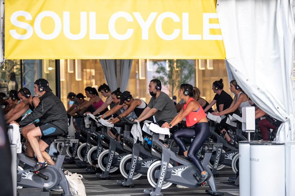 NEW YORK, NEW YORK - SEPTEMBER 24: A man wearing a pulled down mask attends a Soulcycle spin class at the Backyard in Hudson Yards as the city continues Phase 4 of re-opening following restrictions imposed to slow the spread of coronavirus on September 24, 2020 in New York City. The fourth phase allows outdoor arts and entertainment, sporting events without fans and media production.  (Photo by Alexi Rosenfeld/Getty Images)