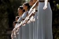 Priestesses dance inside the ancient Olympic Stadium during the dress rehearsal for the Olympic flame lighting ceremony for the Rio 2016 Olympic Games at the site of ancient Olympia in Greece. REUTERS/Yannis Behrakis