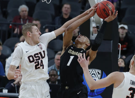 Colorado's Tyler Bey (1) tries to shoot around Oregon State's Kylor Kelley during the second half of an NCAA college basketball game in the quarterfinals of the Pac-12 men's tournament Thursday, March 14, 2019, in Las Vegas. (AP Photo/John Locher)