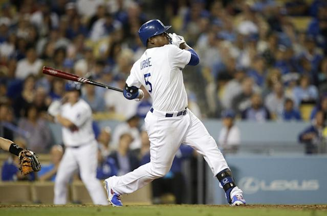 Los Angeles Dodgers' Juan Uribe hits his third solo home run of the game during the fifth inning a baseball game against the Arizona Diamondbacks on Monday, Sept. 9, 2013, in Los Angeles. (AP Photo/Jae C. Hong)