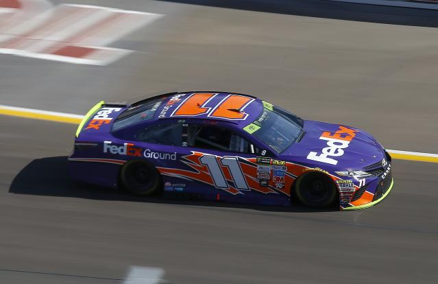 "<a class=""link rapid-noclick-resp"" href=""/nascar/sprint/drivers/1283/"" data-ylk=""slk:Denny Hamlin"">Denny Hamlin</a> (11) leads early during a NASCAR Cup Series auto race at Phoenix International Raceway Sunday, Nov. 12, 2017, in Avondale, Ariz. (AP Photo/Ross D. Franklin)"
