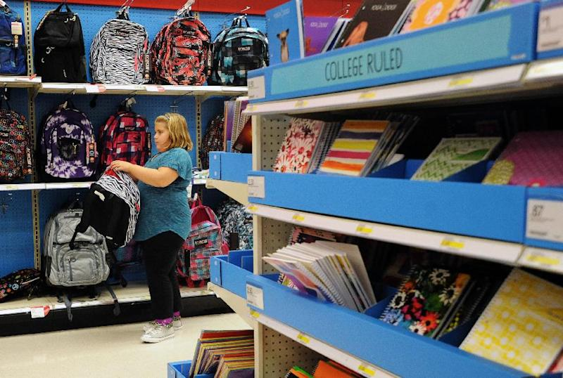 FILE - In this Friday, Aug. 2, 2013, file photo, Raegan Jackson, 10, picks out a backpack shopping at Target in Lynchburg, Va. The government reports on sales at U.S. retailers in August on Friday, Sept. 13, 2013. (AP Photo/News & Daily Advance, Sam O'Keefe)