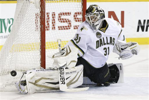 Dallas Stars goalie Richard Bachman blocks a shot against the Nashville Predators in the second period of an NHL hockey game on Friday, April 12, 2013, in Nashville, Tenn. (AP Photo/Mark Humphrey)