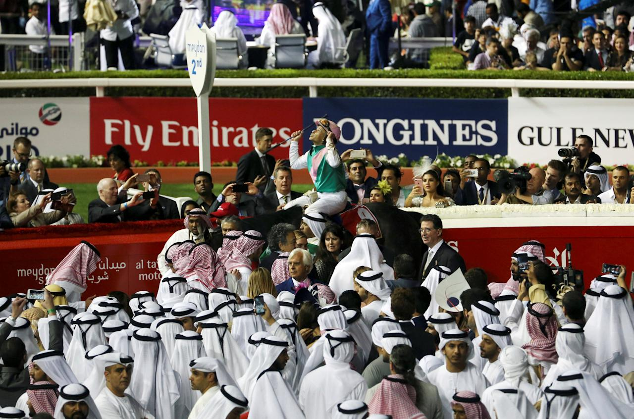 Horse Racing - Dubai World Cup - Meydan Racecourse, Dubai - 25/3/17 - Mike Smith who rodes Arrogate celebrates winning the ninth and final race. REUTERS/Stringer