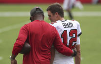 Tampa Bay Buccaneers quarterback Tom Brady (12) talks to offensive coordinator Byron Leftwich before an NFL football game against the Carolina Panthers Sunday, Sept. 20, 2020, in Tampa, Fla. (AP Photo/Mark LoMoglio)