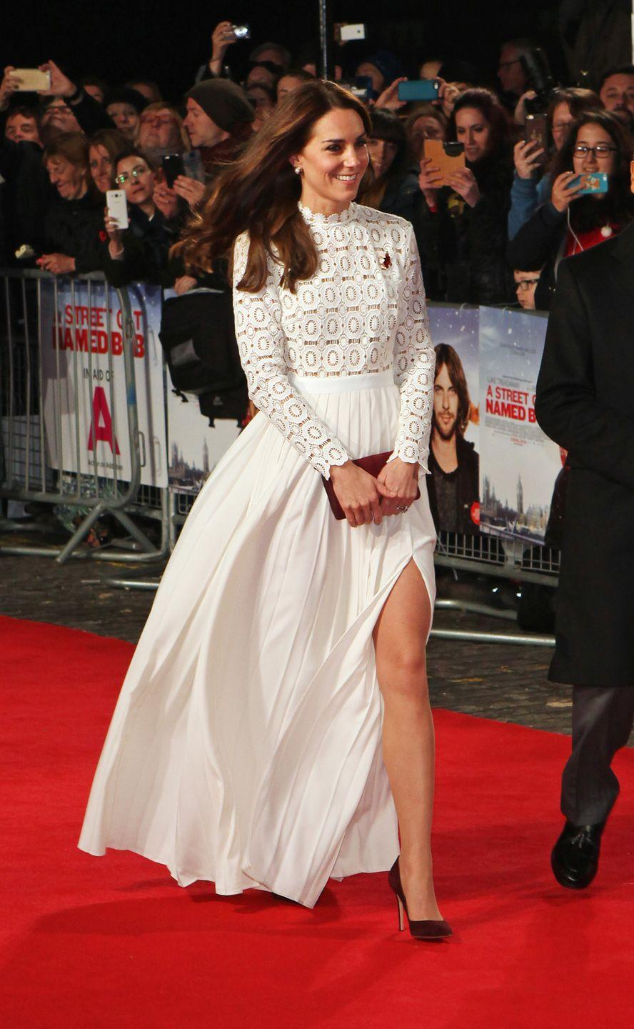 <p>While attending a film premiere in London, the Duchess wore a stunning white gown by designer Self-Portrait, complete with a crochet bodice, poppy pin, and thigh-high side slit.</p>
