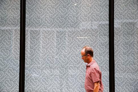 Burberry's new-look monogram, designed by its creative director Riccardo Tisci, is featured at a window outside a Burberry office in central London on July 12, 2019. Photo: REUTERS