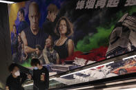 """A poster for the movie """"Fast & Furious 9"""" is seen at a movie theater in Beijing Wednesday, May 5, 2021. Pro-wrestling champion and actor John Cena is apologizing after calling Taiwan a country in promotional interviews for his upcoming film """"Fast & Furious 9."""" (AP Photo/Ng Han Guan)"""